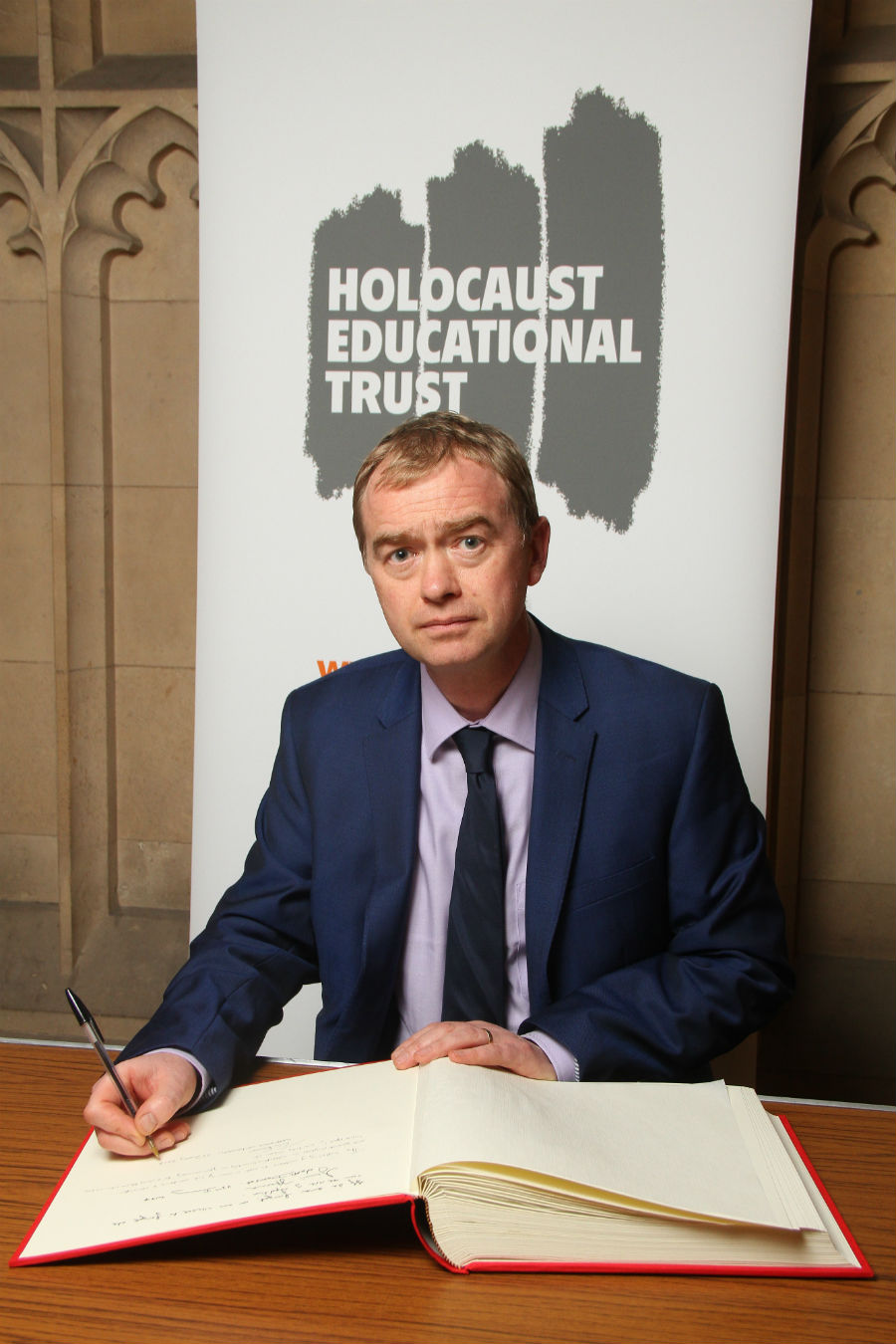 Tim Farron signs the Holocaust Memorial Day commemoration book
