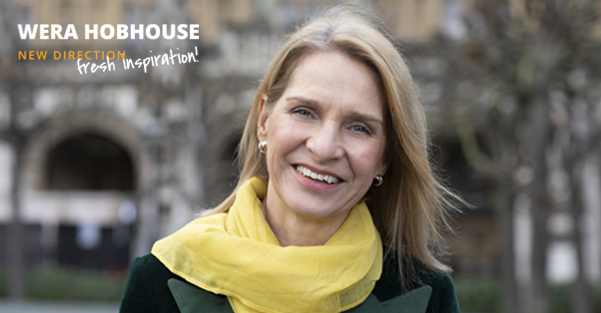Wera, wearing a yellow scarf, smiling at the camera. Text in the top left corner reads 'Wera Hobhouse. New Direction, Fresh Inspiration!'