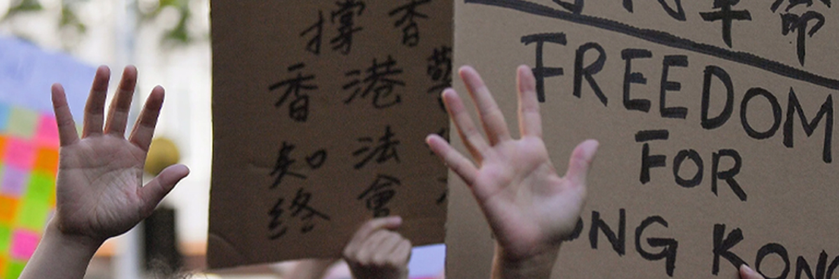 A placard reads 'freedom for Hong Kong'