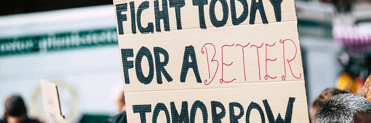 A placard reads 'fight today for a better tomorrow'