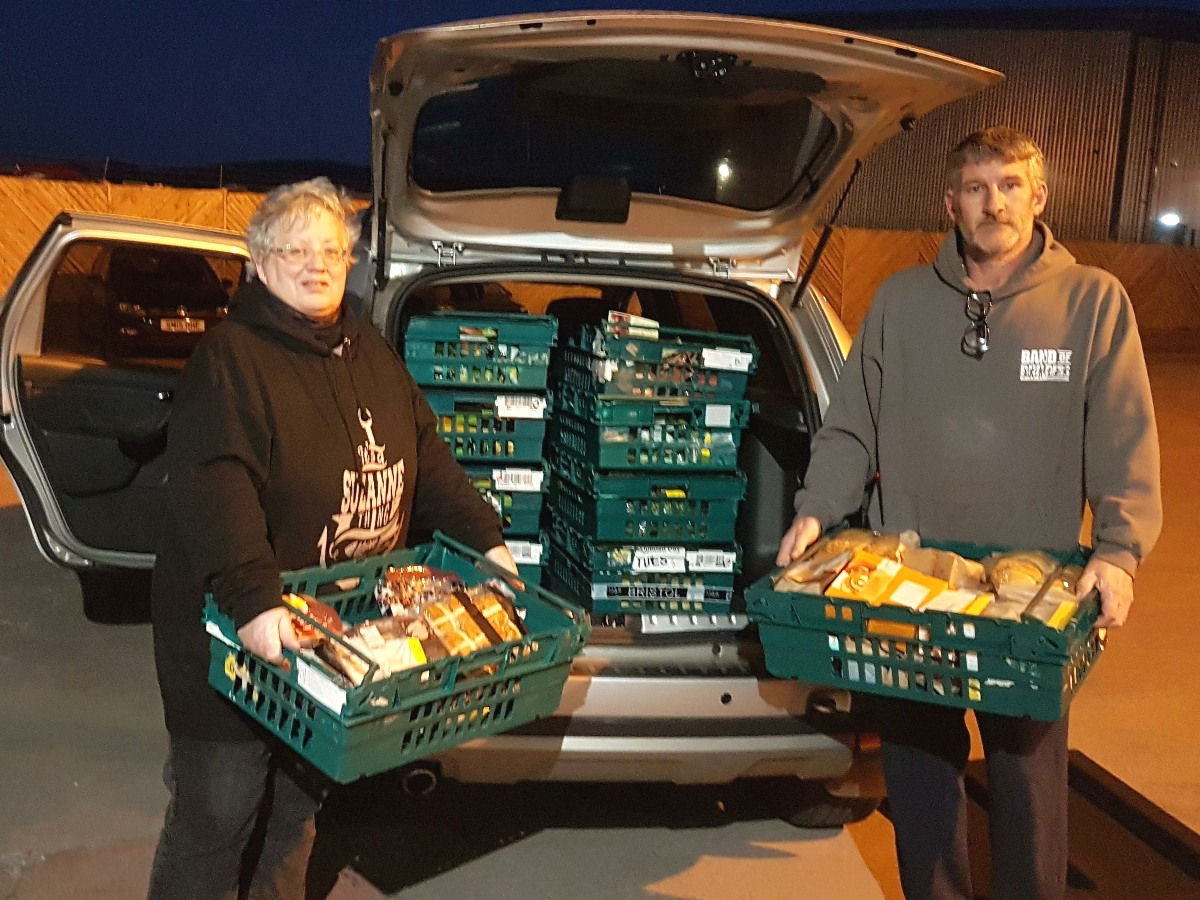 Suzanne and Peter delivering food