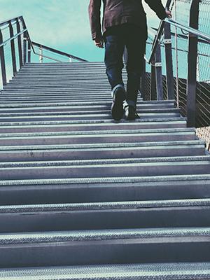 man-walking-up-stairs.jpg