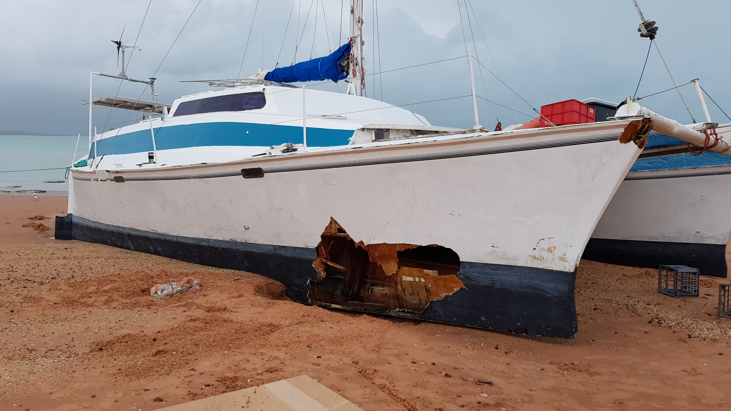 The morning after the storm - the smashed starboard hull of the beached catamaran, the Shaguar. Jason's seamanship and courage got the yacht ashore on a beach during the cyclone, but he couldn't avoid the hidden rocks or mangrove trees.