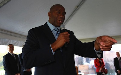 Earvin 'Magic' Johnson gestures at a press<br /> conference