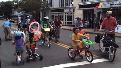 Kids riding with parents on Highland Avenue
