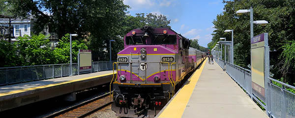 A commuter rail train on the Fairmount Line at a station