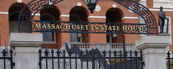 A photo of the Massachusetts state house, zoomed in on the front steps and the words \