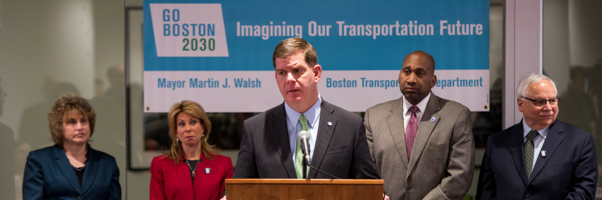 A photo showing Boston mayor Marty Walsh at a podium.