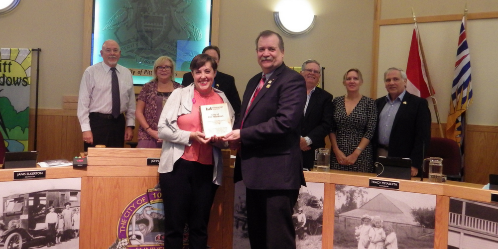 Mayor and Council of Pitt Meadows being presented a plaque by campaign organizer, Deanna Ogle