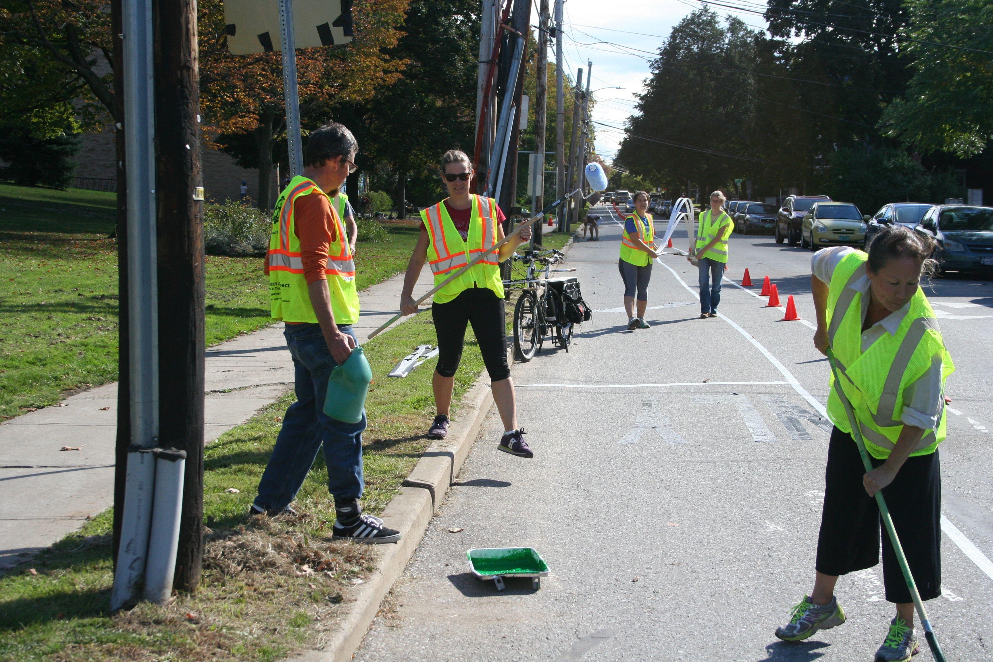 Volunteers painting bike lanes in Burlington