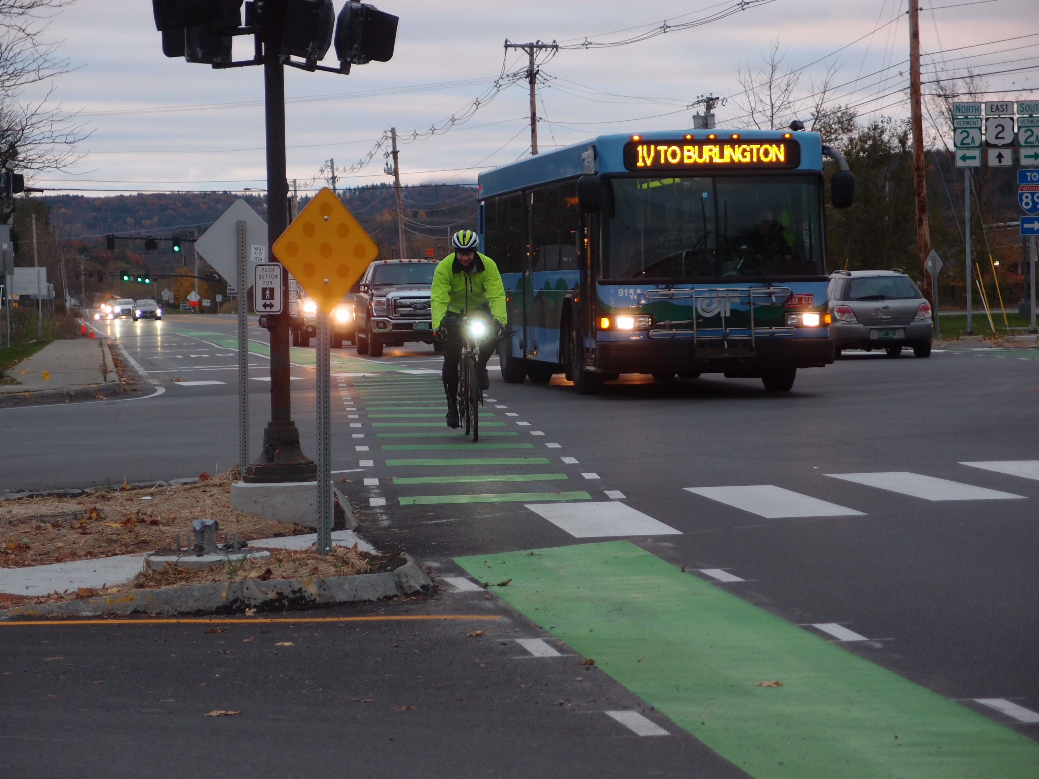 Bike commuter rides in bike lane during after work traffic