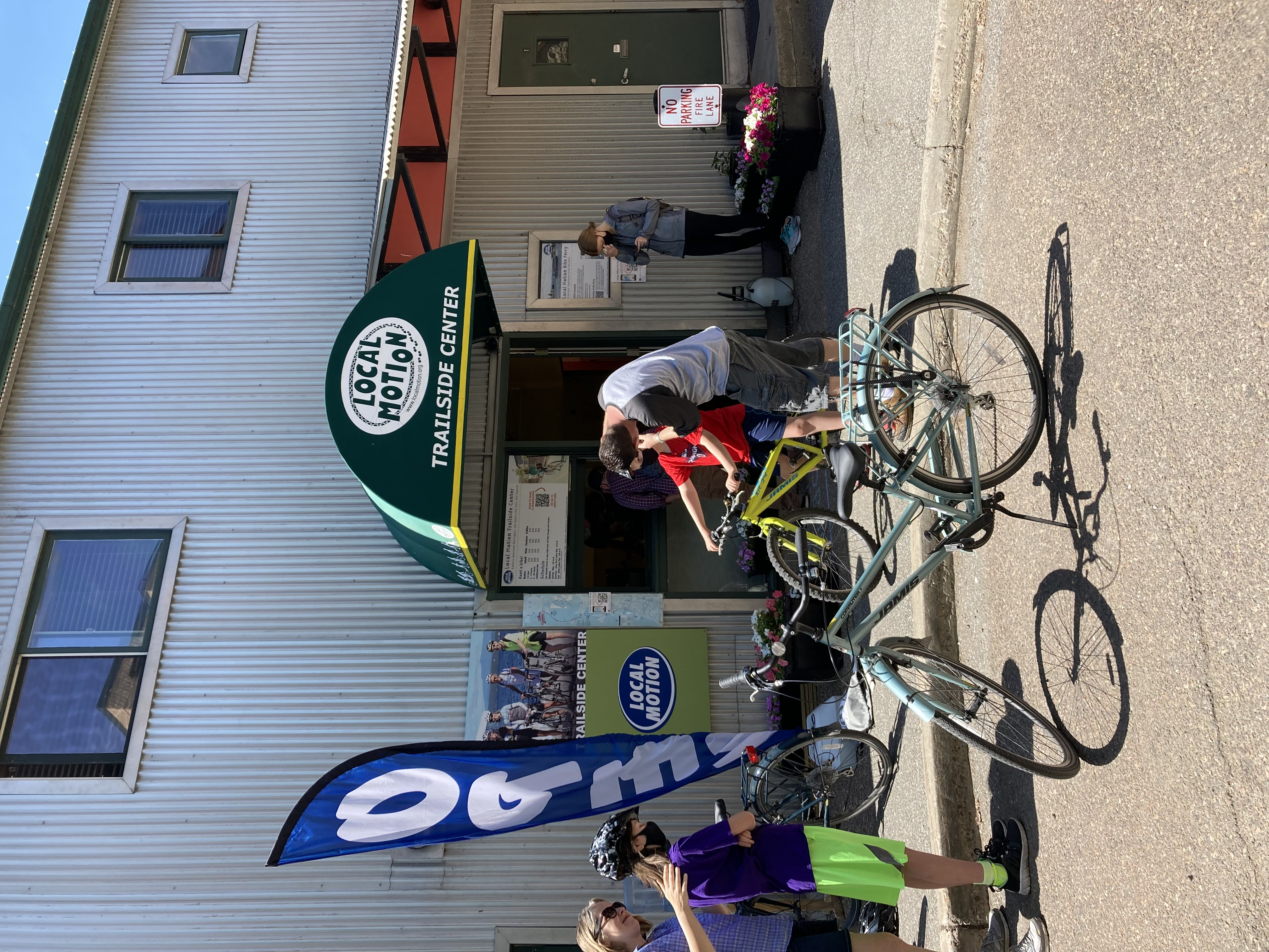 Family renting bikes at the Local Motion Trailside Center on a sunny summers day.