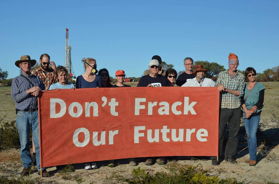People with don't frack our future banner