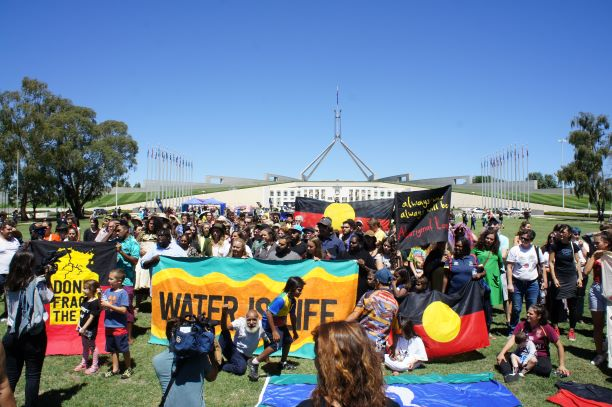 Over 100 Aboriginal and Torres Strait Islander people stand strong for water, country and climate - occupying Parliament House foyer for over an hour