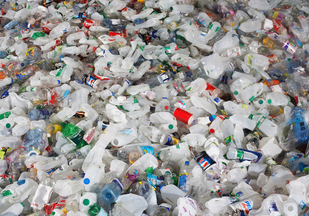 A pile of single-use plastic bottles and cups
