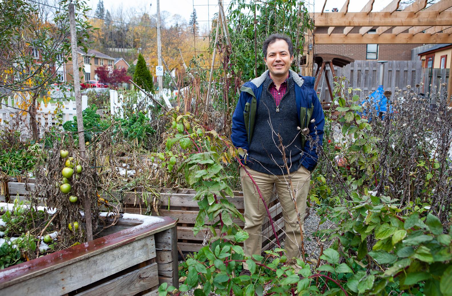 Gabor Sass standing in his home garden