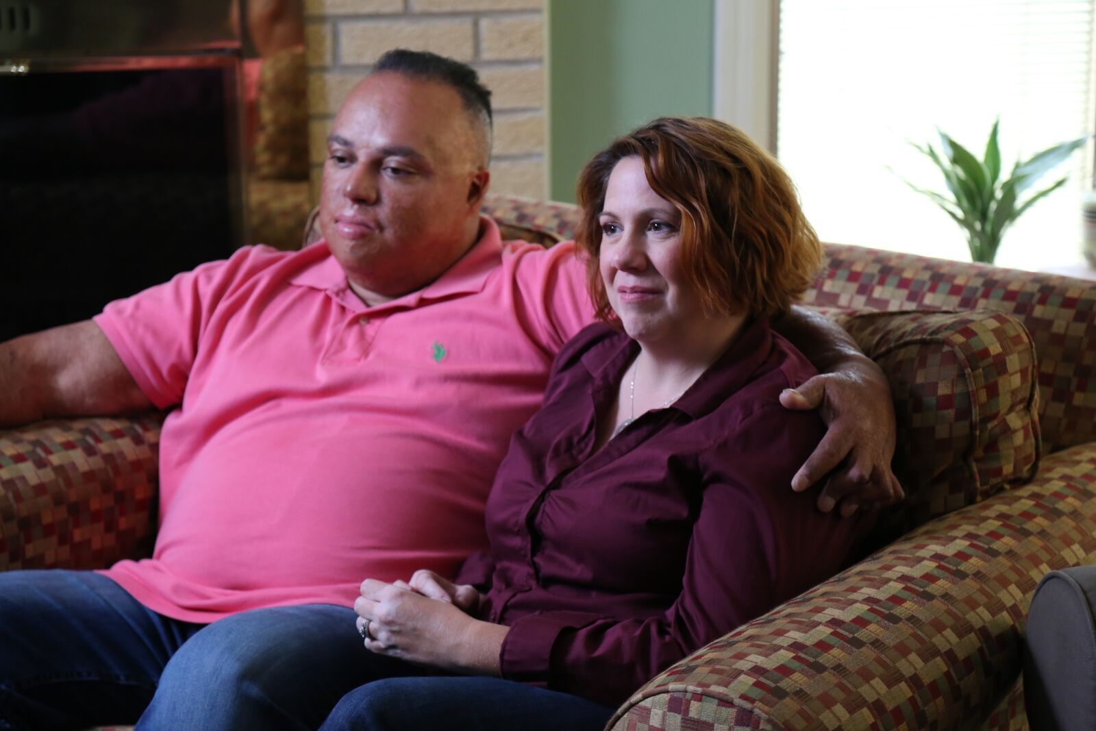 Manny and Laura Gonzalez on loveseat