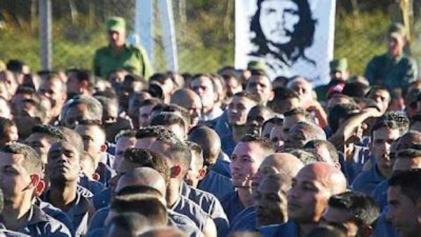 Cuban prisoners in formation under guard supervision