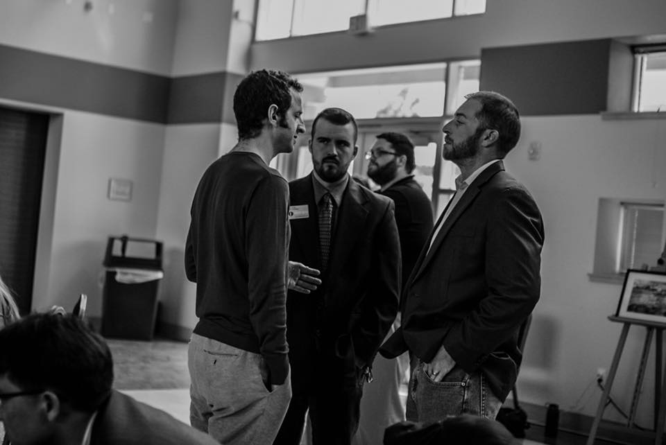 Zach Foster with VP candidate Judd Weiss (left) with Adam Kokesh (right). Photo by Zach Foster.