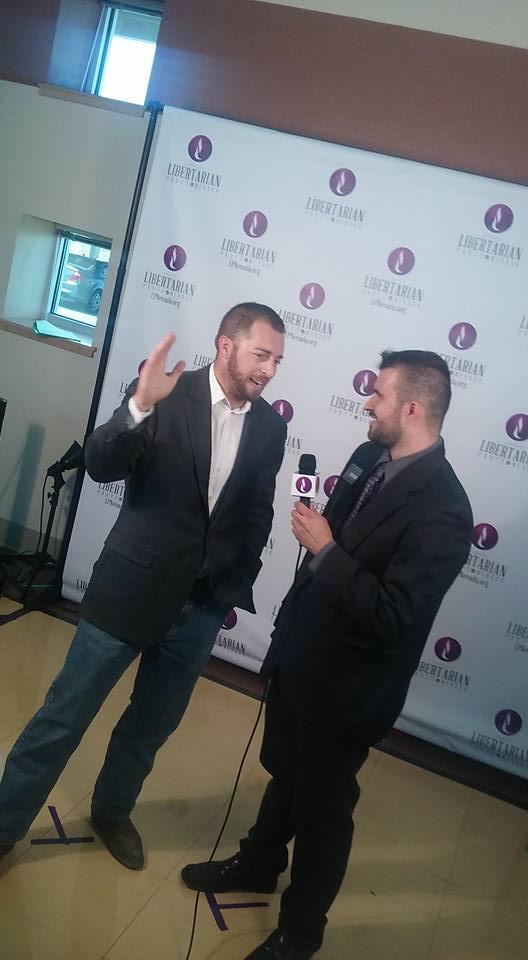Zach Foster interviews Adam Kokesh. Photo by Jason Nellis.