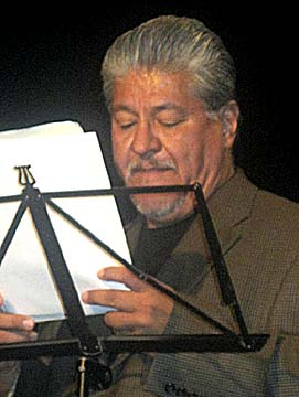 Luis J. Rodriguez reading at the Kamerni Theater, Bosnia-Herzegovina. Photo by Opal Palmer Adisa.
