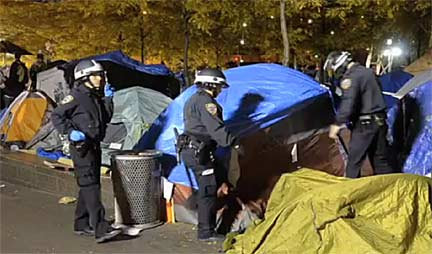 NYPD officers destroy tents and seize property at Occupy Wall Street encampment on Nov. 15, 2011. Still from video footage shot by Rebecca Davis and Julia Xanthos.