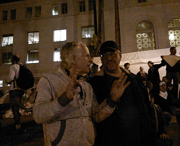 Luis Rodriguez (right) pictured at the Occupy L.A. encampment some hours before it is raided by the LAPD. Standing to Luis' right is friend, Frank Curtis.