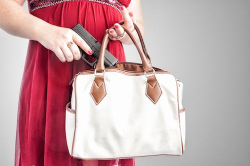 Concealed gun in a handbag