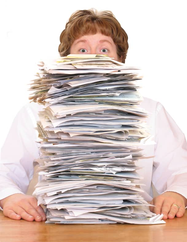 female-pile-of-paperwork.jpg