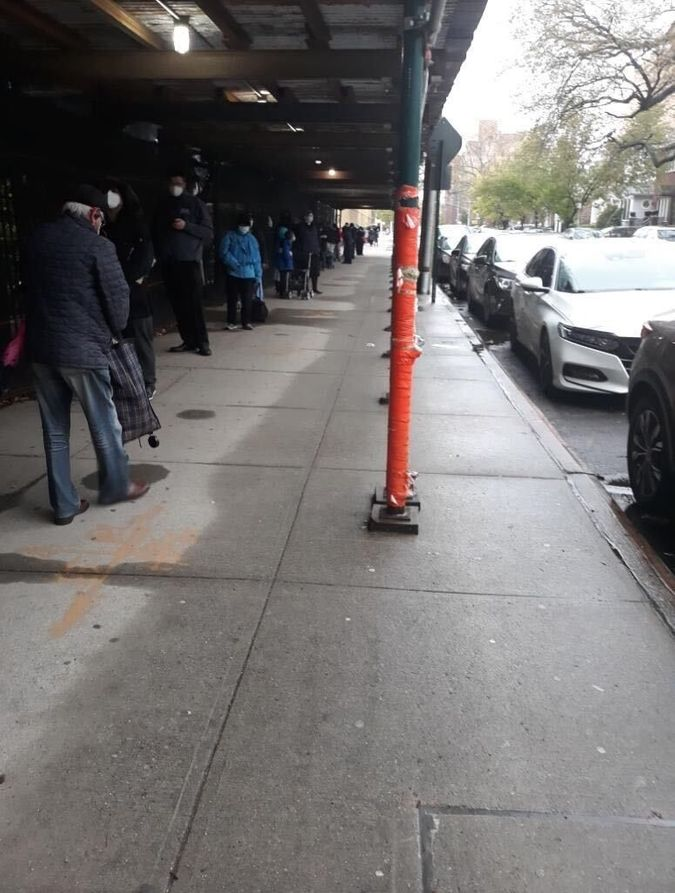 People waiting on line for kosher food at a location in Brooklyn last week.