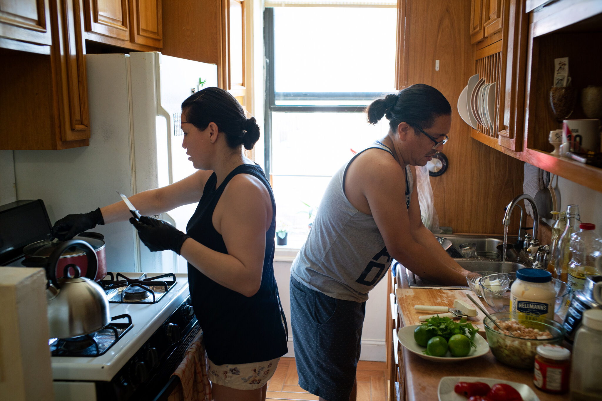 The picture was taken by the New York Time photographer while Jose and Leyla are making the meal with the food from Masbia Soup Kitchen in Brooklyn