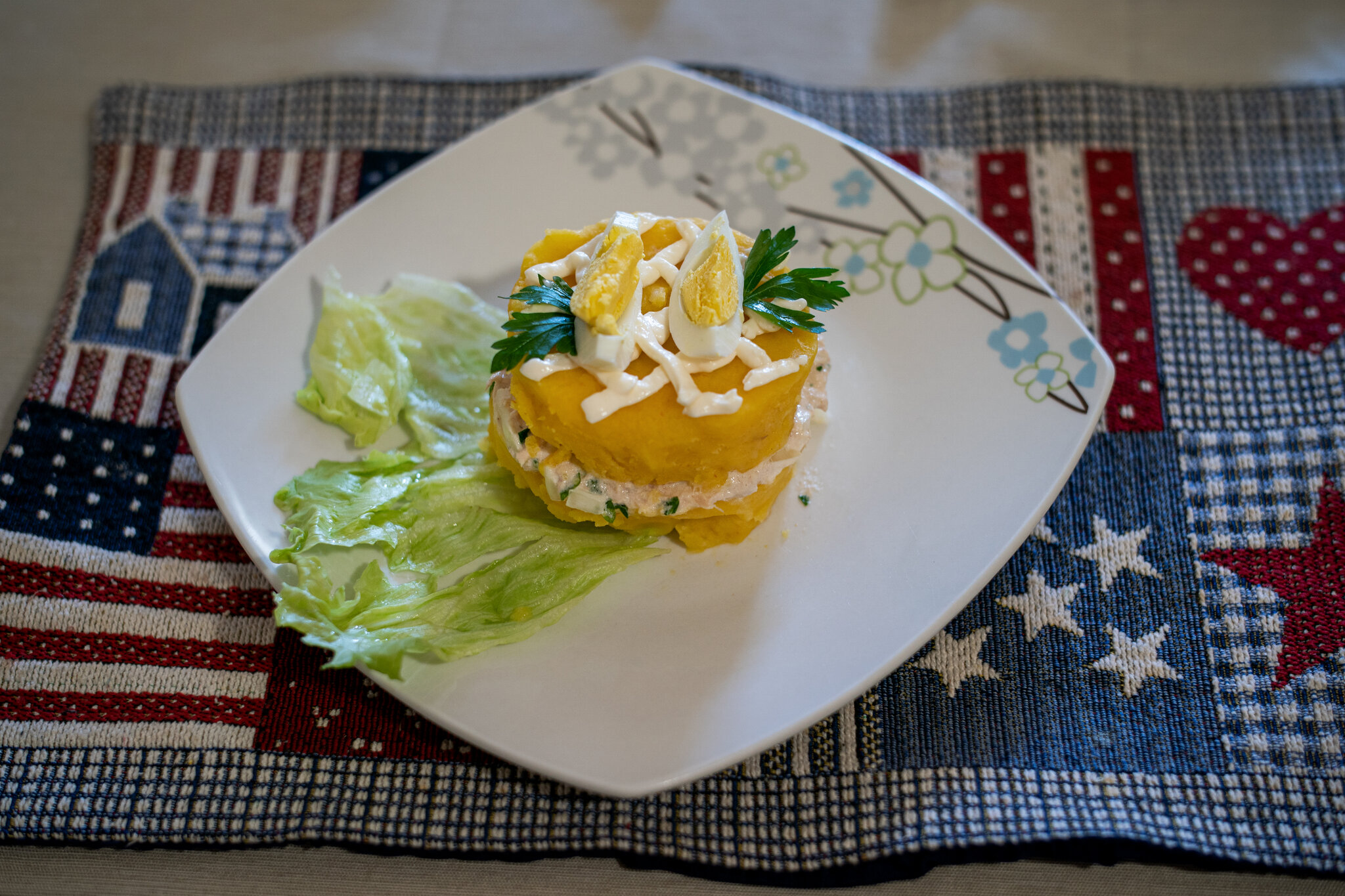 Causa rellena, a traditional Peruvian dish made with potatoes, lettuce, eggs, and onions, all products picked up from Masbia Soup Kitchen in Brooklyn