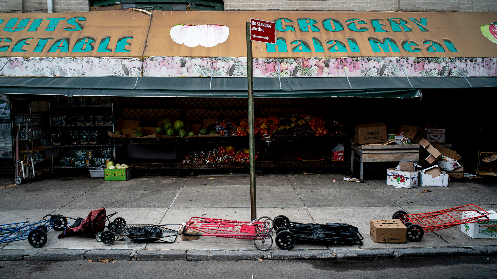 At Masbia, sometimes people save their spot in the line with their carts the picture was taken by the New York Times photographer Todd Heisler