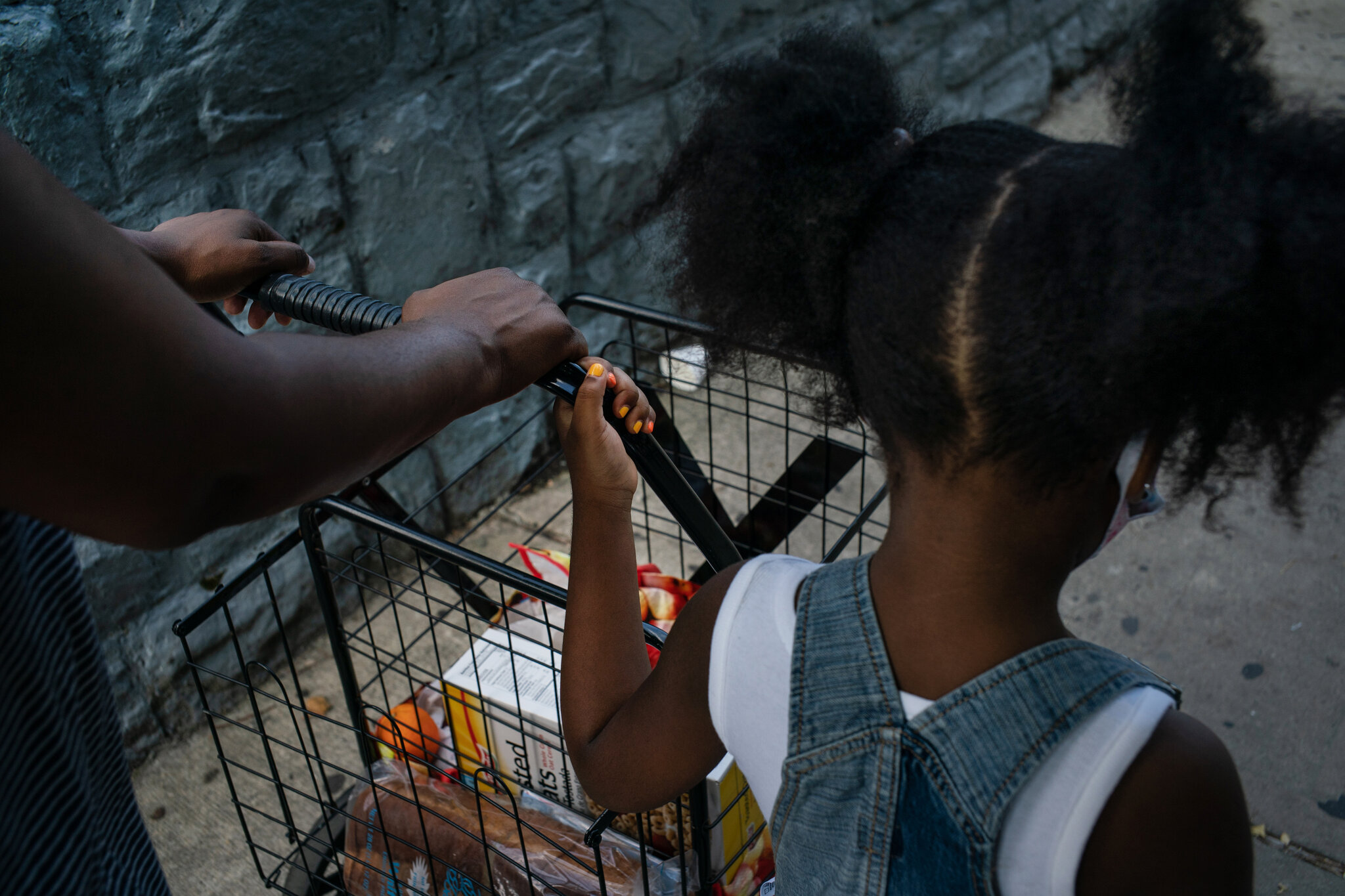 Non-profit_organizations_like_Masbia_in_Brooklyn_made_Leslie_and_her_daughter_Trinity_heading_back_so_happy_to_their_place_after_picking_up_free_food.jpg