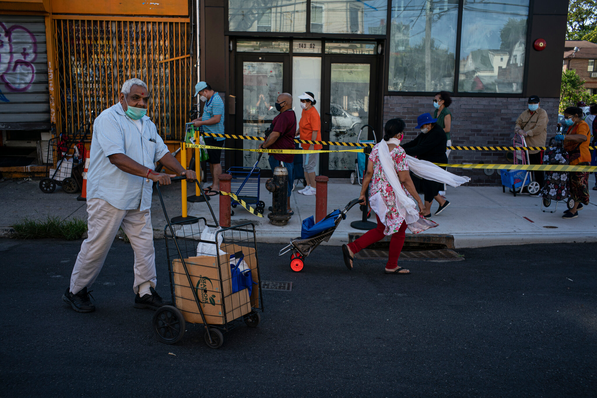 Pantries such as Masbia Soup Kitchen Network makes it possible that family like the Patel pick up food for free. The photo was taken by Todd Heisler of the New York Times