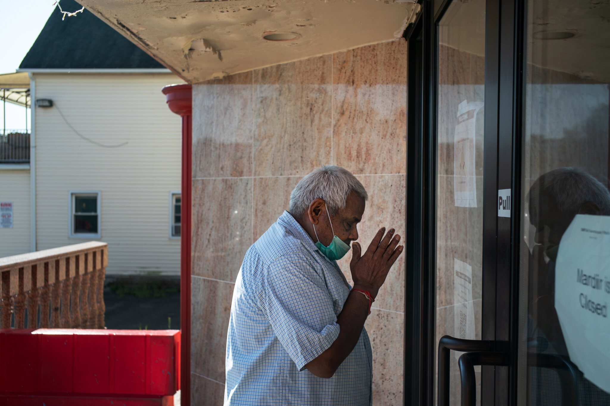 Natvarbahi stops to pray and thanks all pantry nonprofit organizations like Masbia for sharing free food with him and other New Yorkers. The photo was taken by Todd Heisler of the New York Times.
