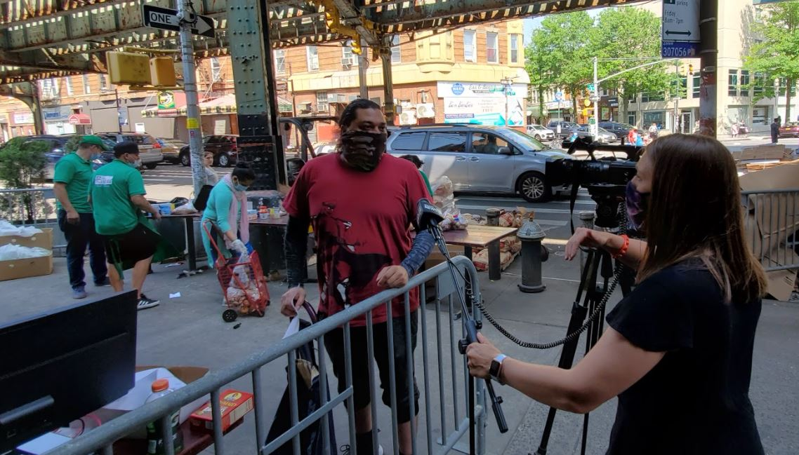 Amanda Farinacci from News NY1 was captured behind the scenes while interviewing one of the clients at Masbia of Boro Park.