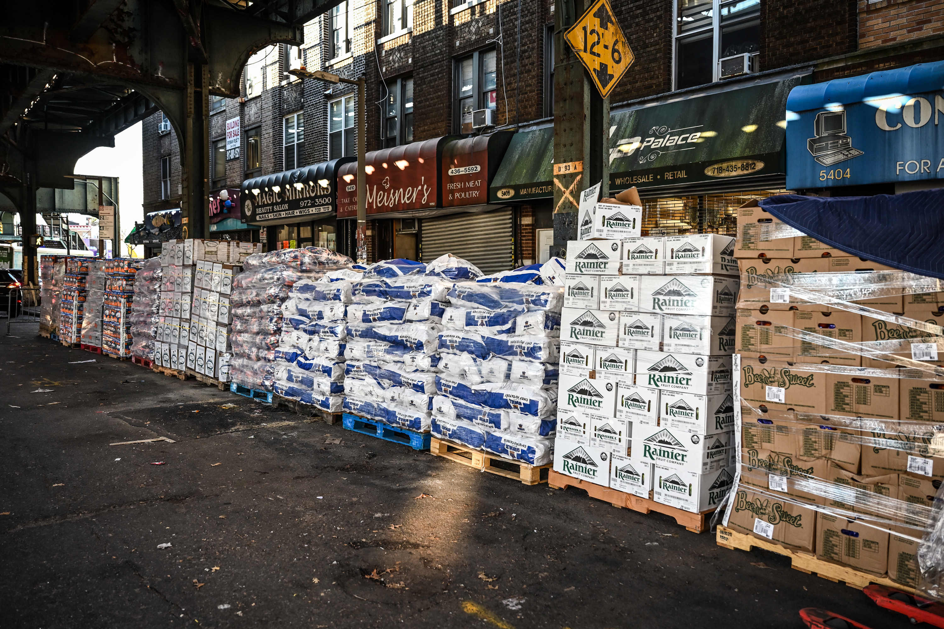 Masbia stocks pallets of food along the sidewalk waiting to be shared with those the needy