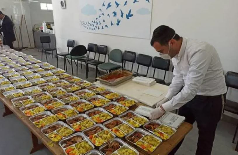 Masbia Soup Kitchen Network workers and volunteers preparing meals for delivery during the COVID19 pandemic