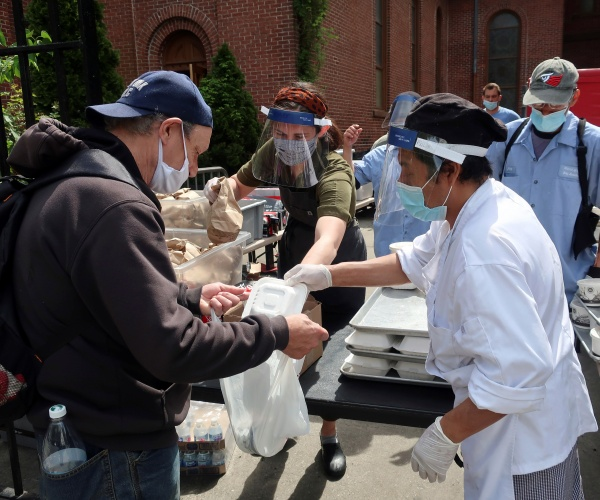 Volunteers of Masbia Soup Kitchen Network, Holy Apostle Soup Kitchen, and other soup kitchen organizations hand out food for those needy.