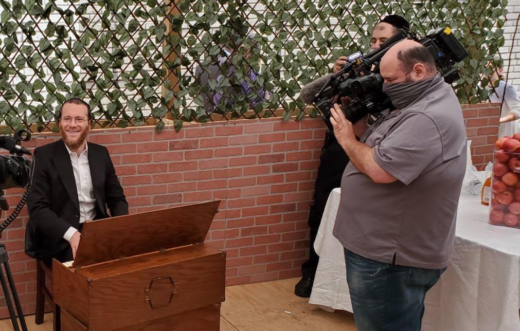 CBS cameraman at Masbia Boro Park in Brooklyn covering Rosh Hashanah holiday