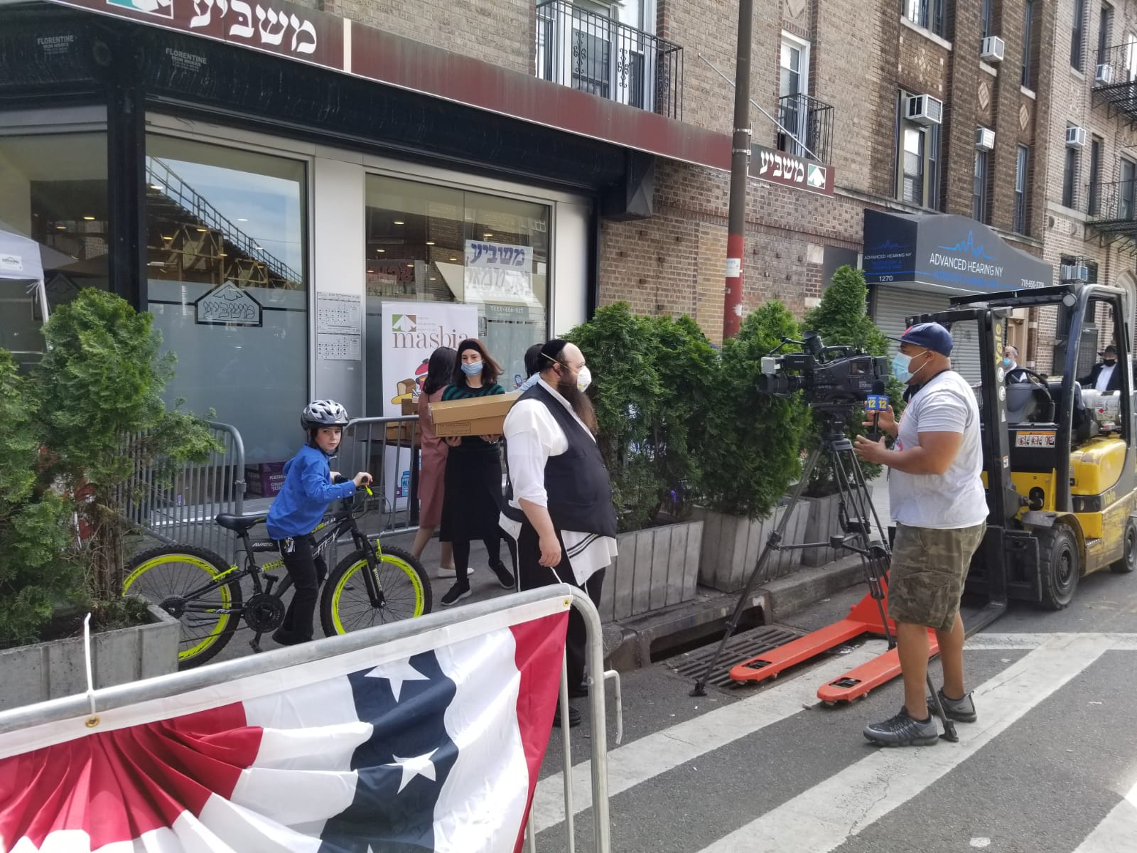 Reporter Christian L Braxton of News12 Brooklyn reported on holiday of Shavuot during covid-19  at Masbia of Boro Park