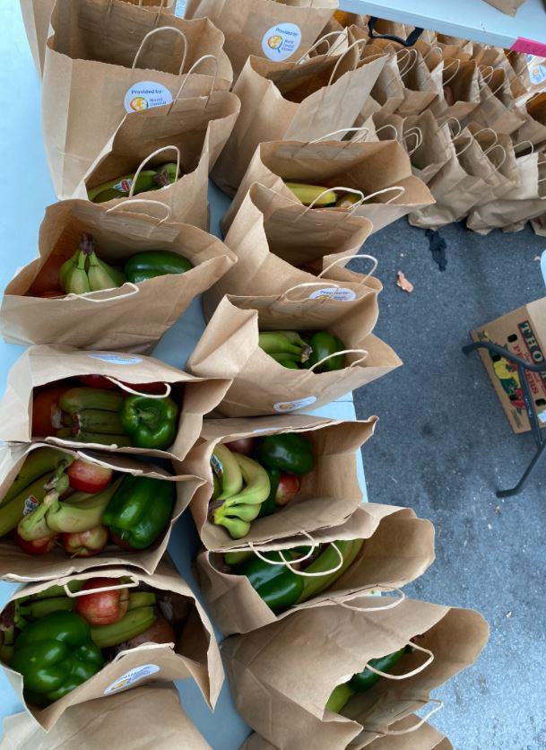 world central kitchen shared brown bags with fresh vegetables during covid-19