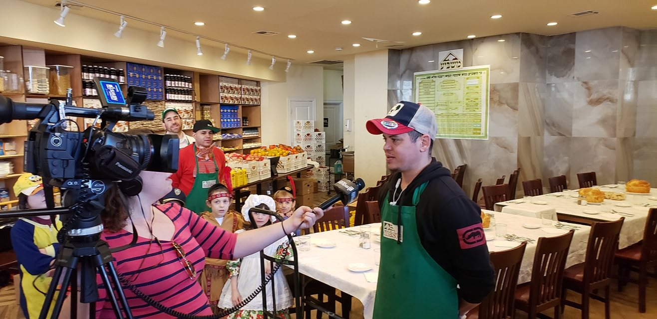 chelsea katz of NY1 interviewing Masbia volunteer