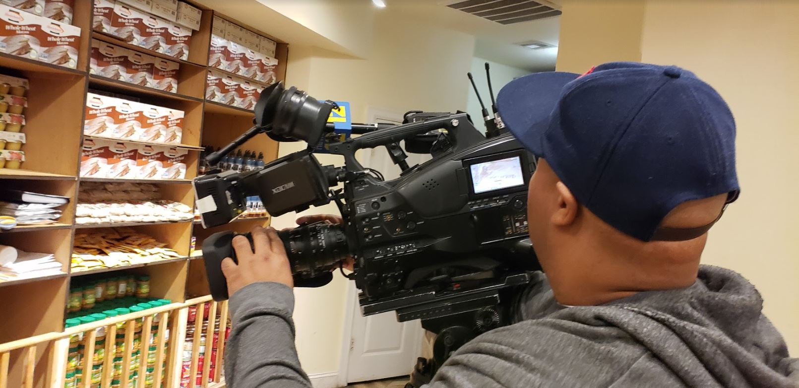 Reporter Christian L Braxton of News12 Brooklyn at Masbia documenting during Purim