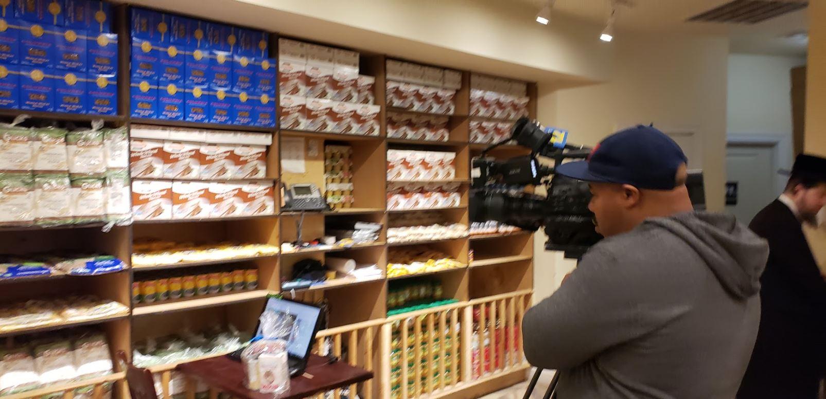 Reporter Christian L Braxton of News12 Brooklyn at Masbia documenting during Purim season