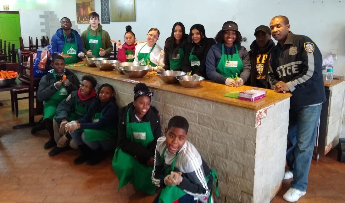 NYPD Youth Leadership Law Enforcement Explorers at Masbia of Flatbush helping to feed those in need