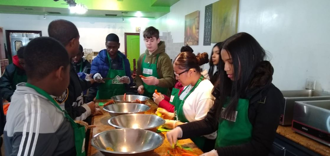 NYPD Youth Leadership Law Enforcement Explorers at Masbia of Flatbush preparing food for those in need