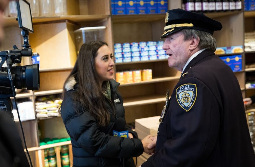 reporter Emily Lorsch reporting at Masbia of Boro Park on MLK Day to Help Puerto Rico