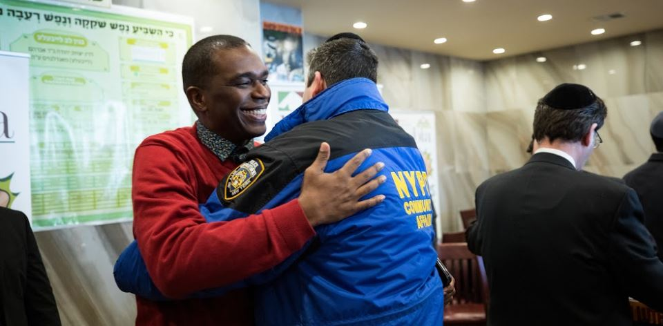 Pastor monrose and NYPD deputy chief Charles Scholl at masbia during MLK Day